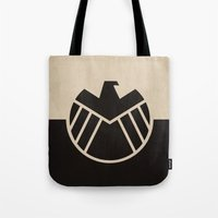 agents of shield Tote Bags featuring Agents fo Shield by The Retro Inc