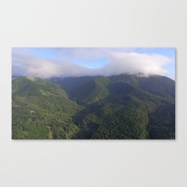 amberley at sunrise green mountains in the clouds Canvas Print