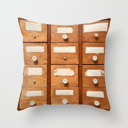 Backgrounds and textures: very old wooden cabinet with drawers Throw Pillow
