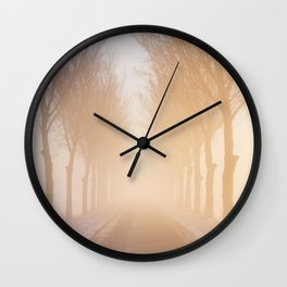 Road through foggy winter polder landscape in The Netherlands, sunrise Wall Clock