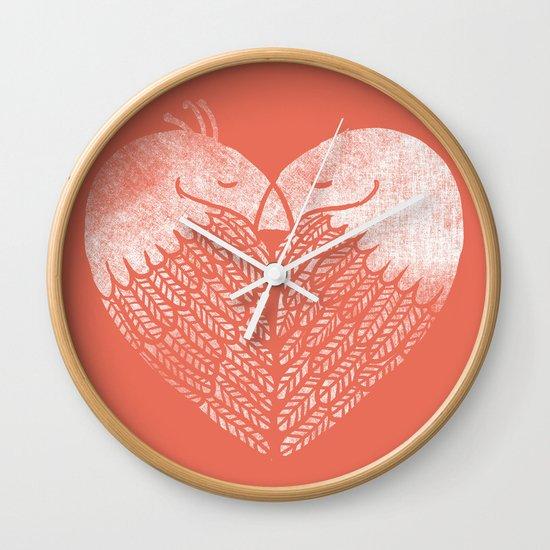 Love birds sitting on a tree Wall Clock