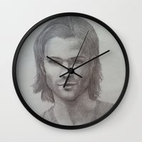 sam winchester Wall Clocks featuring Sam Winchester Graphite portrait by DustyRoseArt