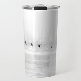 Canadian Geese flying formation  over the river through the fog Travel Mug