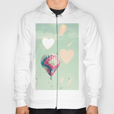 Hot air balloons nursery and heart bokeh on pale blue Hoody