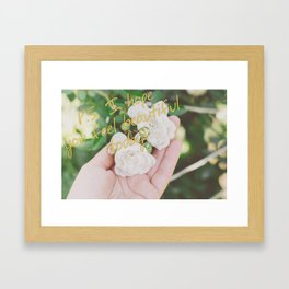 Motivation card on background of two white roses in female hand Framed Art Print