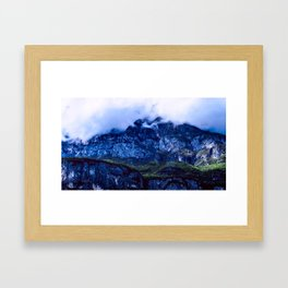 Rocky Mountain covered with clouds Framed Art Print