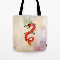 dragon Tote Bags featuring dragon  by mark ashkenazi