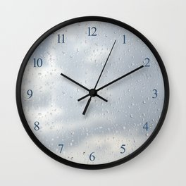 Raindrops flowing down on window glass Wall Clock