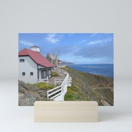 behind the lighthouse Mini Art Print