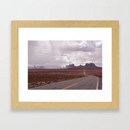 Rain Over Monument Valley Framed Art Print