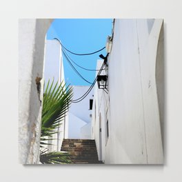 Typical white and narrow Greek street with stone stairs and blue sky Metal Print