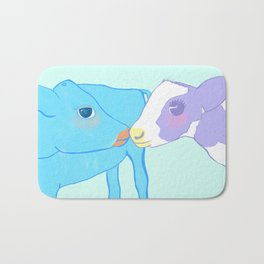 Cow kissing on a pastel background Bath Mat