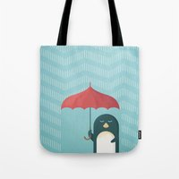 penguin Tote Bags featuring Penguin by Travel Poster Co.