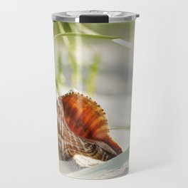 big shell in the sand, in the green of the beach-oats Travel Mug