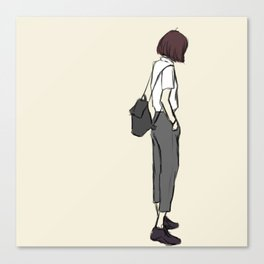 Girl standing while wearing a backpack and looking so cool Canvas Print