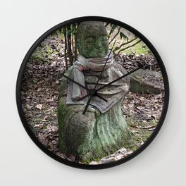 mossy buddha in a faded red bib Wall Clock