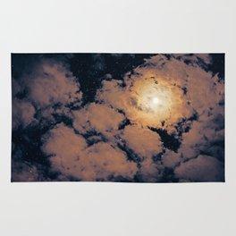 Full moon through purple clouds Rug