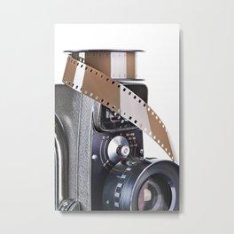 Retro mechanical movie camera and film Metal Print