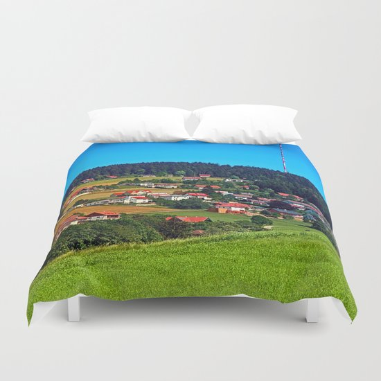Green grass, the village and a transmitter pole Duvet Cover