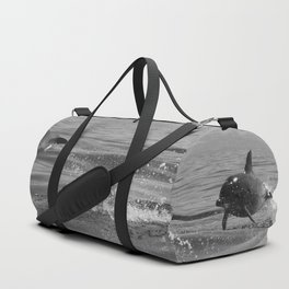 Black and white dolphin race in the ocean Duffle Bag