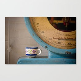 Cup and Scale Canvas Print