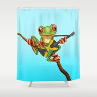 jamaica Shower Curtains featuring Tree Frog Playing Acoustic Guitar with Flag of Jamaica by Jeff Bartels