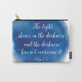The light shines in the darkness, and the darkness has not overcome it. John 1:5 Carry-All Pouch