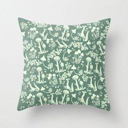 White mushrooms on green background Throw Pillow