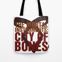 the mortal instruments Tote Bags featuring The Mortal Instruments: City of Bones by thespngames