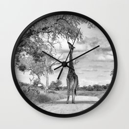 Giraffe on the road Wall Clock