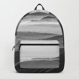 Foggy sunset. Mountains Backpack