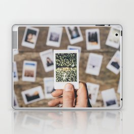 Holding photo prints Laptop & iPad Skin