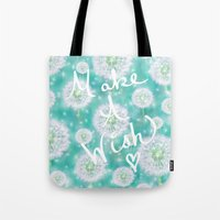 coconut wishes Tote Bags featuring Wishes by Lisa Argyropoulos