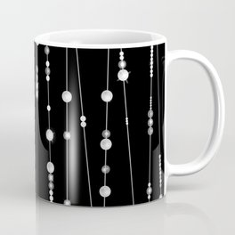 . Pearl beads on a black background Coffee Mug