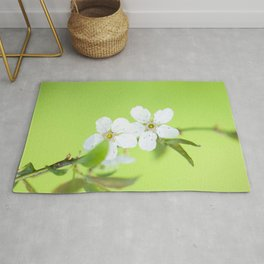 Cherry blossom tree in the green Rug
