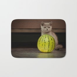 British gray kitten play with a juicy water-melon Bath Mat