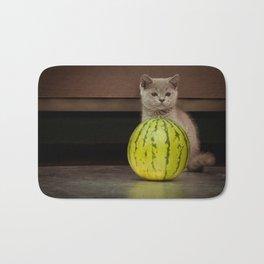 British gray kitten play with a juicy water-melon Bath Mat