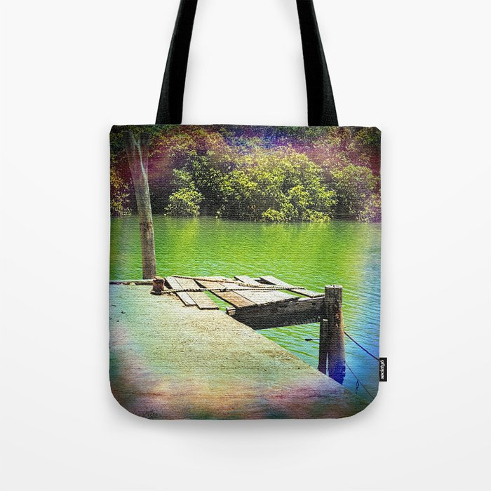 Dilapidated wharf on a tranquil river Tote Bag