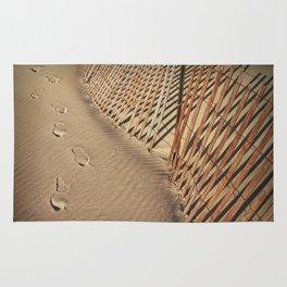 Footprints on the Beach by the Sand Fence Rug