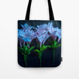 pink and blue flowers on black Tote Bag