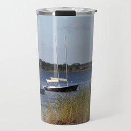 Sailboats moored in front of a natural beach.  Travel Mug