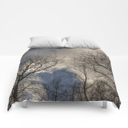 Tree tops with clouds on the background Comforters