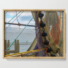 Fishing nets hanging on a boat. Serving Tray