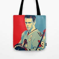 blackhawks Tote Bags featuring Towes One Goal by Thousand Lines Ink