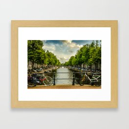 Bikes over a canal bridge in Amsterdam Framed Art Print