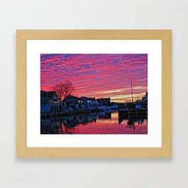 Sunsets over a lagoon. Framed Art Print