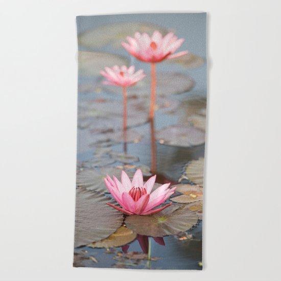 Three Lotus Flowers Beach Towel