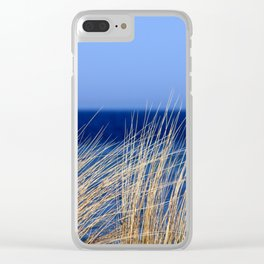 Dried long grass with blue sea behind and blue sky Clear iPhone Case