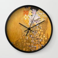 gustav klimt Wall Clocks featuring Gustav Klimt - The Woman in Gold by Elegant Chaos Gallery