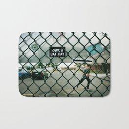 Behind a skate park fence Bath Mat